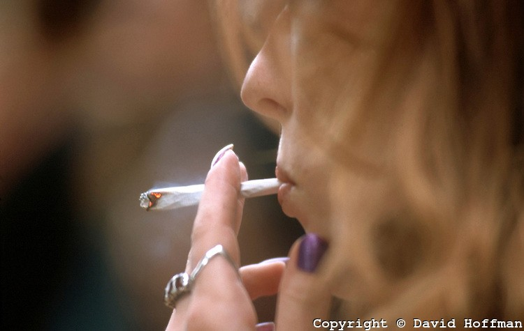 A woman smoking a joint