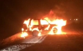 The suspects' pajero jeep is on fire