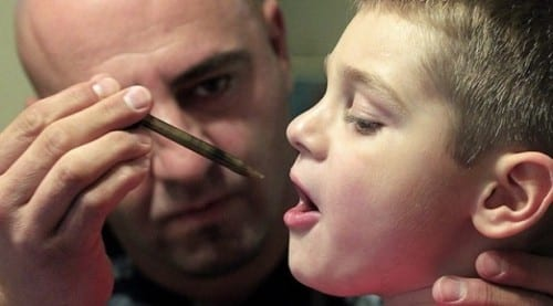 Father gives his sick son Cannabis oil in the syringe