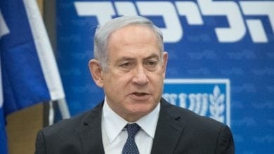 Benjamin Netanyahu against the background of the Likud sign
