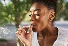 An African woman smoking a joint Cannabis