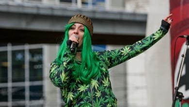 A woman with Cannabis dresses celebrates