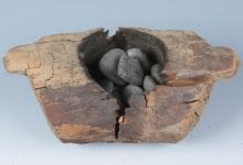 Wooden vessels and charred pebbles that contained traces of cannabis components