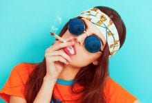 A young woman smoking a joint Cannabis